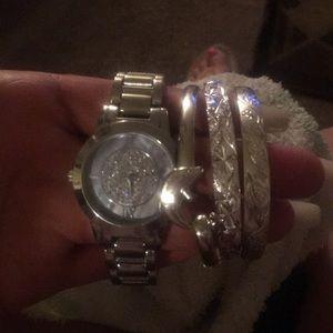 Watch and three bracelets